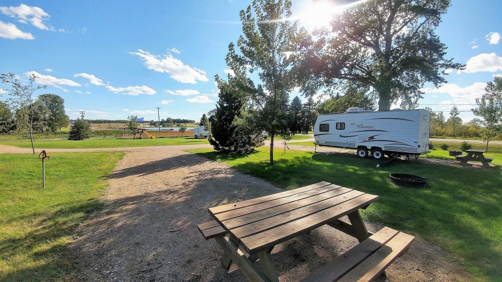 Large gravel pads for any size RV, with picnic tables, fire ring, and across from a lake!